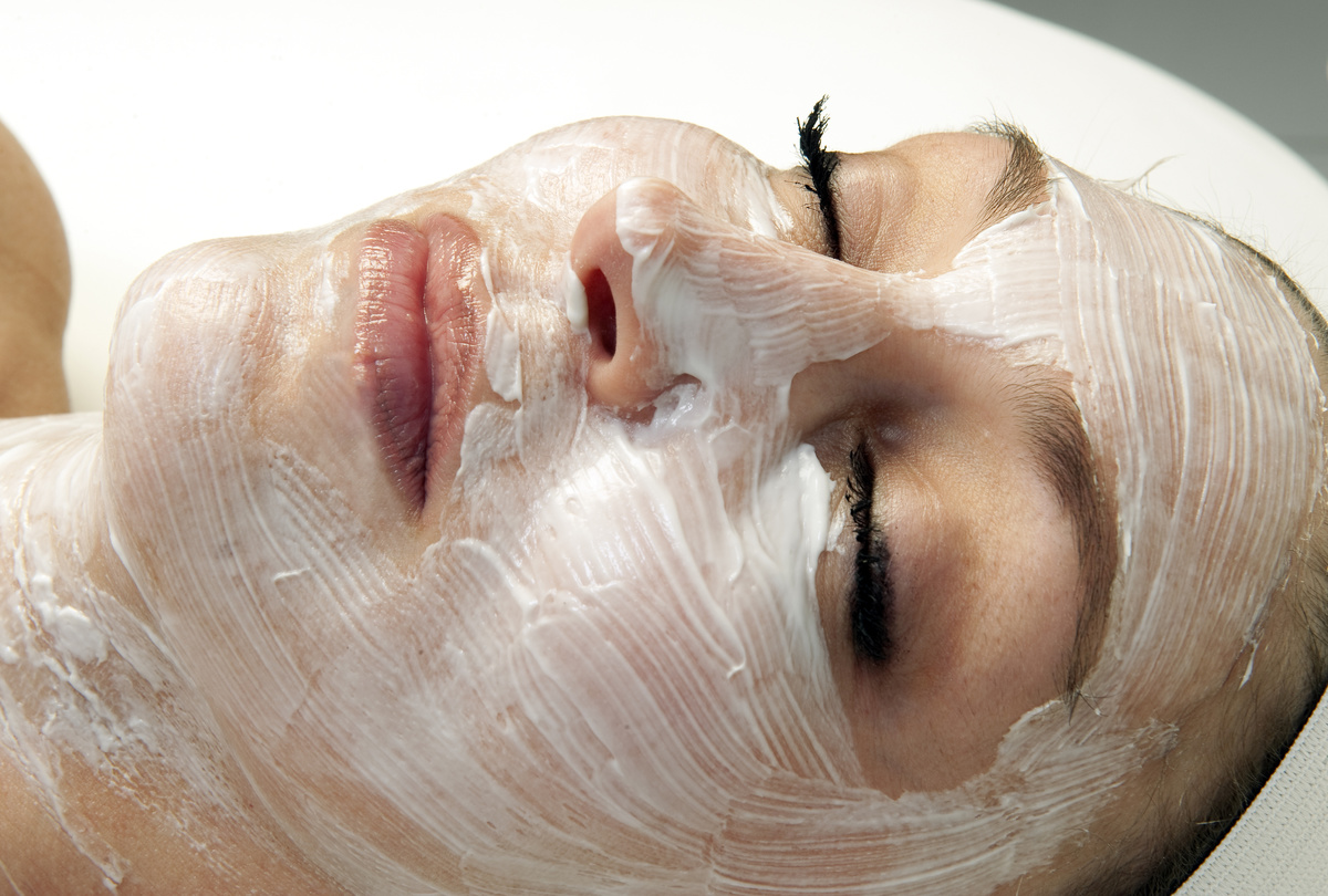 Woman Getting A Facial Treatment At A Spa