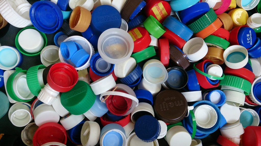 Discs Beneath Bottle Caps