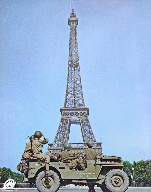 American Soldiers Look At The Tricolor Flag Flying From The Eiffel Tower Again