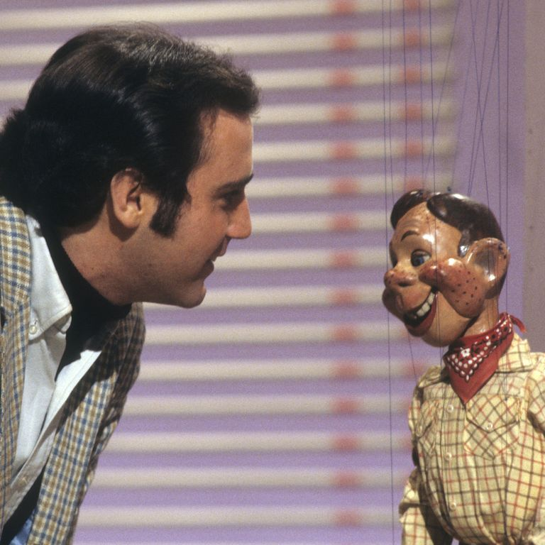 Playing With A Howdy Doody Doll